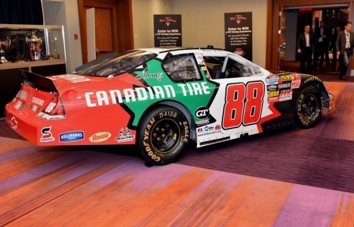 The green maple leaf of Canadian Tire emblazoned on the side of the #88